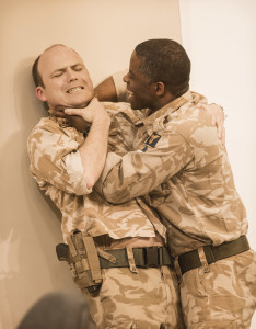 Othello (Adrian Lester) and Iago (Rory Kinnear) tussle in Hytner's latest production. Photograph: Johan Persson